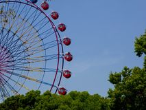 A Ferris wheel's part with blue sky background Stock Photos