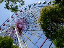 A Ferris wheel's side with blue sky background Royalty Free Stock Photography