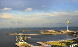 Ferris wheel at sea boulevard in Baku Azerbaijan. Ferris wheel at sea boulevard in Baku and big national flag. Azerbaijan stock image