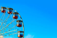 Ferris wheel with a secure closed cabins stock photo