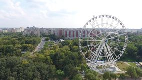 Ferris wheel seen from drone. View of the wheel in an amusement park, seen from drone stock video