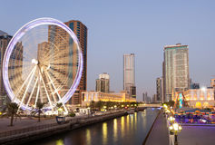 Ferris Wheel in Sharjah City at dusk. Sharjah, United Arab Emirates Royalty Free Stock Images
