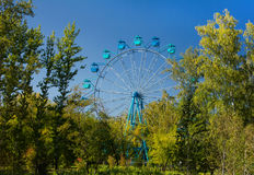 Ferris wheel in Siberia, autumn panoramic view, park area with beautiful trees. Stock Photos