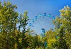 Ferris wheel in Siberia, panoramic view, autumn foliage Royalty Free Stock Photo