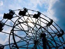 Ferris Wheel Silhouette. A Ferris Wheel amusement ride at a rural country fair under a threatening sky stock images