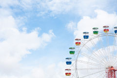 Ferris wheel and sky. Feris wheel with blue sky and clouds Royalty Free Stock Image
