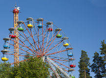 Ferris wheel on sky background. In amusement park Stock Photo