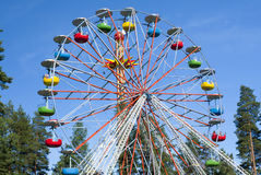 Ferris wheel on sky background. In amusement park Stock Images
