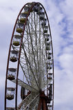Ferris wheel on the  sky with clouds background. Ukraine. Kharki Royalty Free Stock Photos