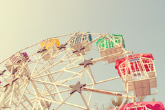 Ferris wheel and sky with retro filter effect (vintage style) Royalty Free Stock Photos