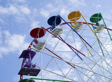 Ferris wheel in sky. Ferris wheel in the space of cloudy blue sky Royalty Free Stock Photo