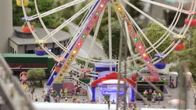 Ferris wheel in small city. ST. PETERSBURG - JULY 2016: Ferris wheel in a small city, Russia. The Grand Maket, which opened in 2011, is a 1:87 scale replica of stock video