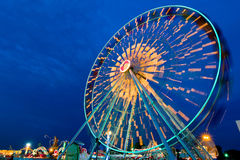 Ferris wheel spin outdoor motion at twilight. Royalty Free Stock Photography