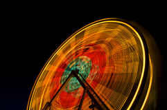 Ferris Wheel. Spinning at night stock image