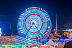 Ferris Wheel Spinning. Night long exposure shot of ferris wheel at the 50th State Fair, Aloha Stadium, Oahu, Hawaii Stock Photo