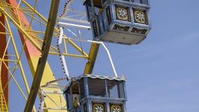 Ferris wheel on a spring festival in Munich, Bavaria - April 25 2018 stock video footage