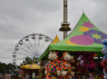 Ferris Wheel and stuffed animals on midway at state fair Royalty Free Stock Image