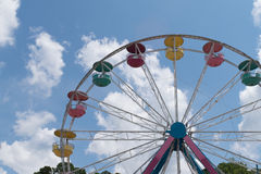 Ferris wheel on summer day at county fair Stock Photo