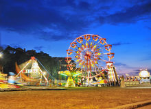 Ferris wheel in a summer night stock image