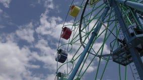 Ferris wheel in the summer Park. Ferris wheel in the summer City Park stock video footage