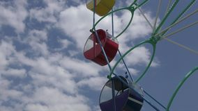Ferris wheel in the summer Park. Ferris wheel in the summer City Park stock footage