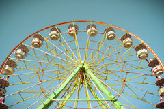 Ferris wheel on a sunny afternoon. Ferris wheel goes around in a sunny blue sky royalty free stock images