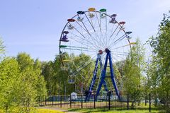 Ferris wheel in sunny summer day against clear blue sky Royalty Free Stock Photos