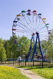 Ferris wheel in sunny summer day against clear blue sky, vertical Stock Image