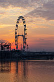 Ferris wheel with sunrise Royalty Free Stock Photo