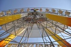 Ferris wheel at sunrise. Vintage Retro Ferris Wheel on Blue Sky stock photography