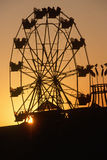 Ferris Wheel at Sunset. Ferris wheel silhouetted at sunset on the Santa Monica Pier in Los Angeles, CA Stock Photography