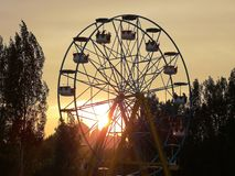 Ferris wheel at sunset stock photos
