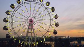 Ferris wheel at sunset on promenade in slowmotion. 1920x1080 stock video footage