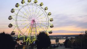 Ferris wheel at sunset on promenade in slowmotion. 1920x1080 stock footage