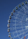 Ferris wheel Texas Star and setting moon Royalty Free Stock Photography