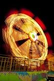 Ferris wheel at theme park. Long exposure of a ferris wheel at theme park at night royalty free stock photo