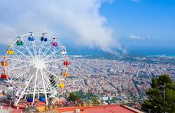 Ferris wheel in Tibidabo with panoramic view over Barcelona. It is located at free access area of stock images