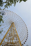 Ferris wheel towering in blue sky Stock Image