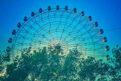 Ferris wheel with trees royalty free stock photo