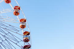 A ferris wheel turns against a blue sky at Wittenburgh Christmas Royalty Free Stock Image