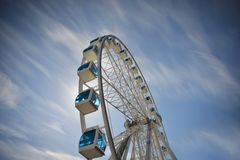 Ferris wheel under blue dramatic skies Royalty Free Stock Photo