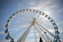 Ferris wheel under blue dramatic skies Stock Image