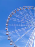 Ferris wheel under a blue sky Royalty Free Stock Photo