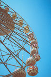 Ferris wheel vintage style. Ferris wheel and blue sky vintage style royalty free stock photo