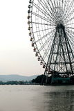 Ferris wheel on water Stock Images