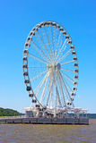 Ferris wheel on the water edge. Stock Photography