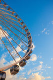 Ferris wheel on the water at sunset Royalty Free Stock Images