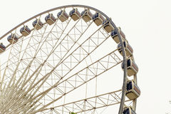 Ferris wheel on white. Ferris wheel stops on a white background and the rain gently feeling lonely Royalty Free Stock Photography