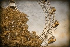 Ferris Wheel in Wien against a blue sky - Vintage and Retro Phot. O Effects added royalty free stock photography