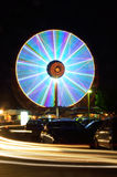 Ferris wheels in motion at night Stock Image
